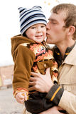 Father kissing his son. Happy father kissing his little son stock images