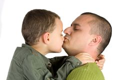 Father kissing his son. Isolated on white royalty free stock photos