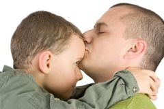 Father kissing his son. Isolated on white royalty free stock images