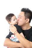 Father kissing with his son Royalty Free Stock Photos