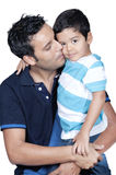 Father kissing his son. Isolated on white royalty free stock image