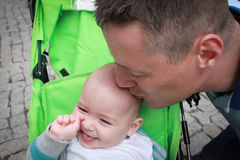 Father kissing his son, outdoors. Smiling little boy, near his father Royalty Free Stock Photography