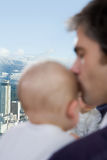 Father kissing his sons head Stock Images