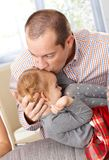 Father kissing little daughter's head Stock Photography