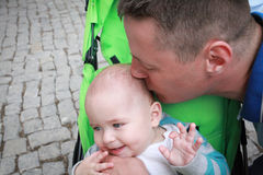 Father kissing Stock Images