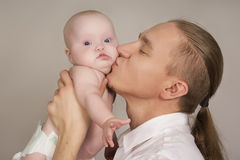 The father kissing the newborn child Stock Photo