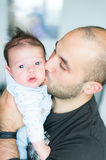 Father kissing son. Father kissing his son on the cheek Stock Image