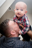 Father Kissing Son On Stomach Royalty Free Stock Photography