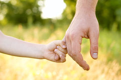 Father lead by the hand son Royalty Free Stock Photography