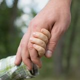 Father lead by the hand son Royalty Free Stock Images