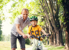 Father learn his son to ride bicykle Royalty Free Stock Photos