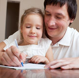 Father learning daughter royalty free stock images