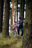 Father learning his son to ride on bicycle outside Stock Photo