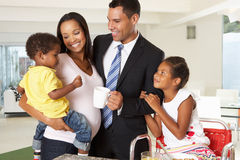 Father Leaving Family Breakfast For Work Royalty Free Stock Images