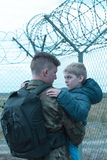 Father leaving son. Young soldier is saying goodbye to his child Stock Image