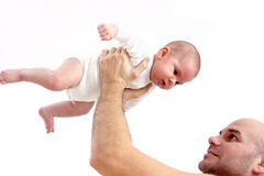 Father lifting baby up Royalty Free Stock Image