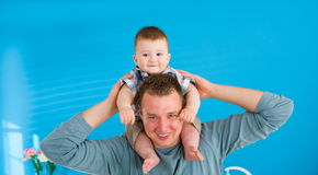 Father lifting happy baby stock photos
