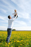 Father lifting his son up in the sky Royalty Free Stock Photo