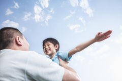 Father lifting son. Royalty Free Stock Images
