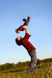 Father Lifting Son Stock Image