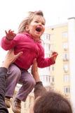 Father lifting up  girl Stock Photos