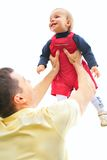 Father lifts  son on hands Royalty Free Stock Image