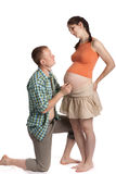 Father listening heartbeat of his future child Royalty Free Stock Photography