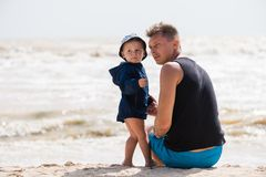 Father and little baby boy at the beach royalty free stock photos