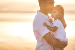 Father and little baby daughter on beach at sunset Stock Photography