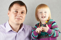 Father with  little blond daughter look toward Stock Photo