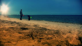 Father and little boy on the beach playing stock footage