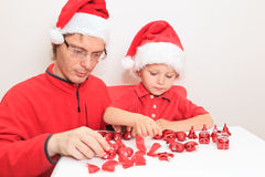 Father and little boy in Santa hat sorting. Christmas gifts, Christmas concept Royalty Free Stock Photography
