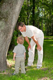 Father and little child in park Royalty Free Stock Image
