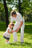 Father and little child in park in summer day Royalty Free Stock Photos