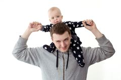Father with little child on shoulders. Cheerful father playing and carrying infant son on shoulders isolated on white Stock Photo