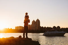 Father with little child at sunset Stock Image