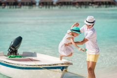 Happy father and his adorable little daughter at tropical beach having fun royalty free stock images