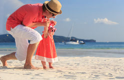 Father and little daughter on the beach Stock Photography