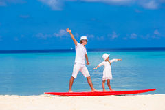 Father with little daughter at beach practicing Royalty Free Stock Image