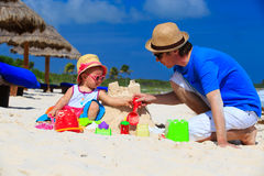 Father and little daughter building sandcastle on Royalty Free Stock Images