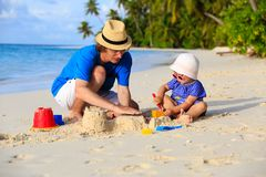Father and little daughter building sandcastle on Royalty Free Stock Photography