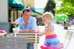 Father and little daughter drinking in cafe Royalty Free Stock Photo