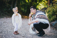 Father and little daughter eating pears Stock Photo