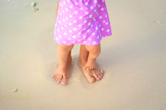 Father and little daughter feet on a tropical beach Stock Photography