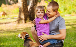 Father with little daughter on the green meadow Stock Photography