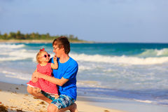 Father and little daughter having fun on beach Royalty Free Stock Photo