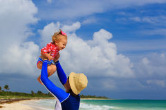 Father and little daughter having fun on the beach Royalty Free Stock Images