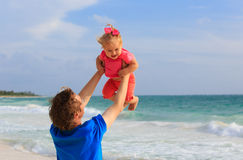 Father and little daughter having fun on beach Royalty Free Stock Image