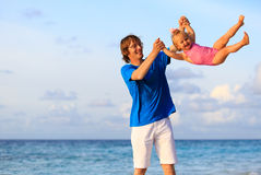Father and little daughter having fun on beach Royalty Free Stock Images