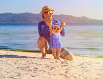 Father and little daughter having fun on the beach Royalty Free Stock Photo